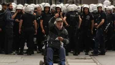 Dissenter: A man protests in front of a police line in Istanbul's Taksim Square, marking the first anniversary of the 2013 Gezi Park protests.