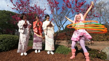 Yuko Yamomoto, Hitomi Kurosawa, Yukie Ota, with Shiho Sparkle Hooper the Hula Hoop performer at the Auburn Botanical Gardens.