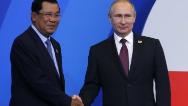 Cambodian Prime Minister Hun Sen, left, shakes hands with Russian President Vladimir Putin  at the ASEAN-Russia summit in Sochi, Russia, on May 20.