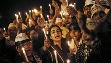 Protesters hold a candlelight vigil at an anti-rape demonstration in Delhi in 2014.