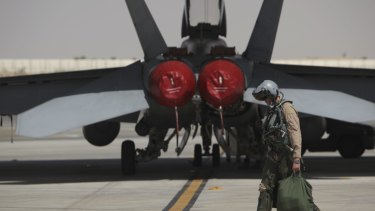 In harm's way: A Royal Australian Air Force F/A-18F air combat officer prepares for a combat mission in Iraq.