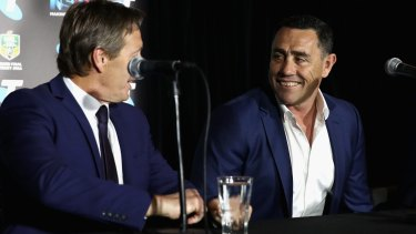 Frenemies: Melbourne Storm coach Craig Bellamy talks to Cronulla Sharks rival Shane Flanagan during the NRL Grand Final press conference at Sydney Opera House on Thursday.