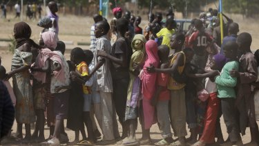 Children displaced after attacks by Boko Haram line up in a refugee camp in Yola, Nigeria.