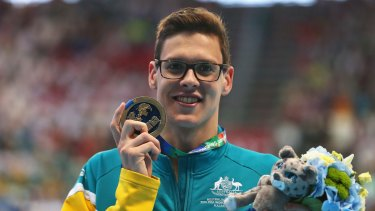 Breakout moment: Mitch Larkin celebrates his 200m backstroke gold medal at the world championships in Russia.