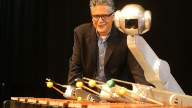 Professor Gil Weinberg with Shimon Robot which improvises jazz at Robotronica.