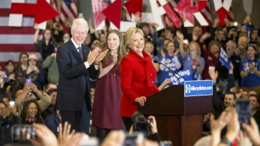 Democratic presidential candidate Hillary Clinton, accompanied by former President Bill Clinton and their daughter Chelsea Clinton, arrives at her caucus night rally at Drake University in Des Moines, Iowa.
