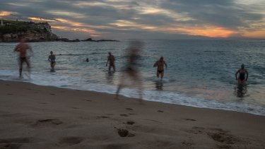 Swimmers enjoy the warm weather at Coogee Beach on Tuesday.