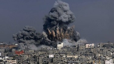 Heavy smoke billows following an Israeli military strike in Gaza City.