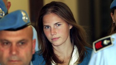 Amanda Knox, escorted by Italian penitentiary police officers to Perugia's court, in 2008.