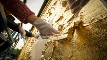 It has taken three weeks to cover the building in gold leaf for the installation, titled The Light and the Ground.