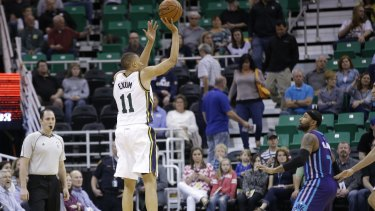 Shooting star: Utah Jazz guard Dante Exum hits a three-pointer during the big win over Charlotte on Monday.