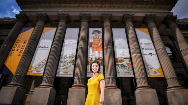 Hey that's me: Lawyer Natasha Sim with Explore, her whimsical portrait of herself aged 10, which will adorn the State Library of Victoria front entrance until the end of January.
