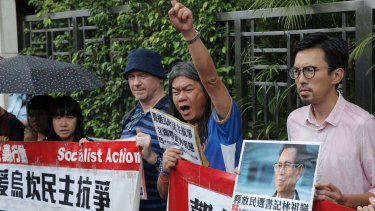 Radical pro-democracy lawmaker Leung Kwok-hung, second from right, and other protesters during a demonstration outside the Chinese central government's liaison office in Hong Kong, last week.