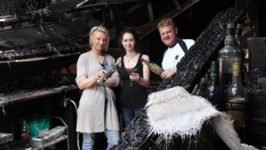 Former Armidale Club owner Kate Richards with manager Courtney Parker and co-owner Allen St James, inside the club's ruins.