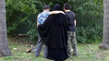 The 16-year-old boy, pictured on the right in 2014, spoke to Fairfax Media after his family home was raided.
