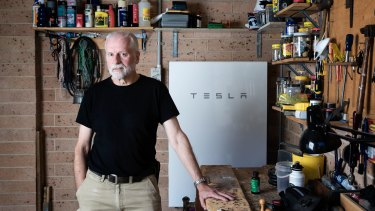 Peter Youll with his Tesla battery, which has paid for itself before the warranty ran out.