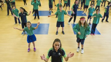 Kaleen Primary School students perform their Dance Nation routine for the chief minister on Monday.