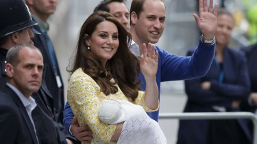 Britain's Prince William and Kate, Duchess of Cambridge with their newborn baby, Princess Charlotte Elizabeth Diana, wave as they leave hospital on Saturday..