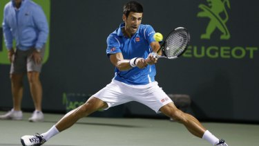 Novak Djokovic returns service to Tomas Berdych.