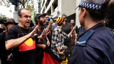 Protesters confront police outside Parliament House last week, demonstrating against the NSW government's anti-protest laws.