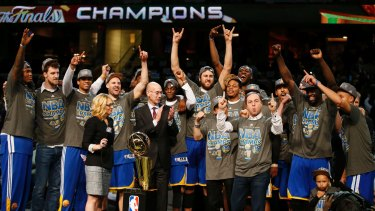 Deserved champions: The Golden State Warriors celebrate with the Larry O'Brien NBA Championship Trophy.