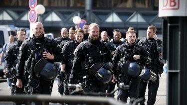 Riot police patrol ahead of the G20 in Hamburg.