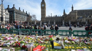 Tributes in London's Parliament Square for those who lost their lives in the attack.