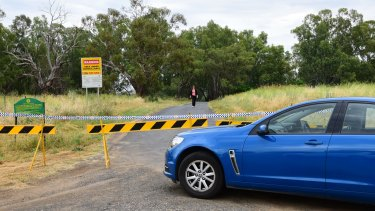 Police seal off a site near Butlers Falls on Tuesday as they search for Lateesha Nolan's remains.