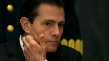 A journalist who exposed Mexican President Enrique Pena Nieto (pictured) over a luxury home found spyware on his phone.