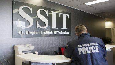 AFP officers at St Stephens Institute of Technology. Its owners were charged with serious fraud offences on Wednesday.