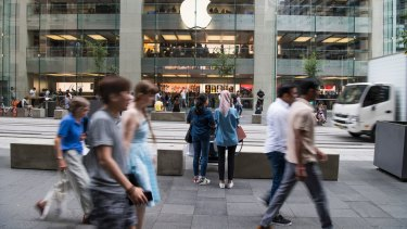Shoppers stream past the Apple store in Sydney's George Street.