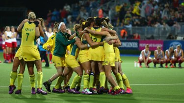 Pleasure and pain: the Hockeyroos celebrate as a distraught England watch on