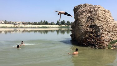 Iraqis jump off the ruins of an old building into the Tigris River to beat the heat in Baghdad this month. The temperature in Baghdad reached 47 degrees.