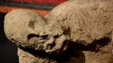 A plaster cast of a body discovered buried in volcanic ash in the ancient Roman city of Pompeii.