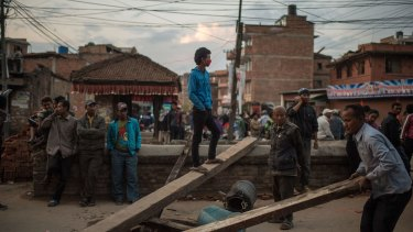 Earthquake survivors block a street as they protest the lack of help from the government in Kathmandua.