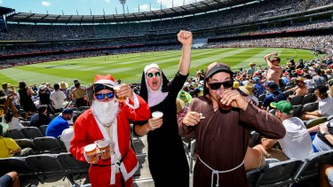 Father Christmas, Sister Cricket and Father Cannon get into the spirit of the Test.