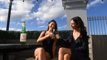 Lauren Ostler, 26, and Allie Frame, 30, enjoying their ciders on the rooftop at the Royal Hotel Paddington.