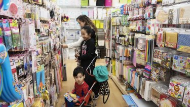 The Choy family browse products at Daiso's new store in Lidcombe.