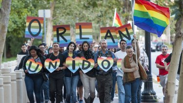 Several hundred gay rights activists march in Santa Ana, California in supports of the victims of the Orlando massacre.