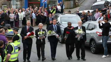 MP Hilary Benn, Speaker of the House of Commons John Bercow, Prime Minister David Cameron, Speaker's chaplain Reverend Rose Hudson-Wilkin and Labour Leader Jeremy Corbyn arrive to pay their respects near to the scene of the murder of Jo Cox.
