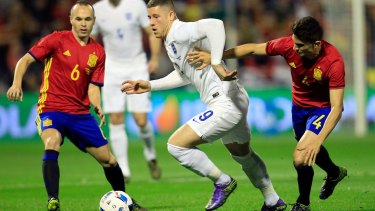 Clash of cultures: England's Ross Barkley tries to break down the Spanish defence.