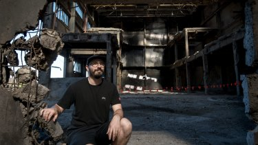 Street Artist Rone inside the old Amcor factory in Alphington.