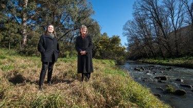 Darebin mayor Kim Le Cerf and Yarra mayor Amanda Stone by Merri Creek, on the border of the two councils.