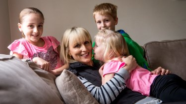 Kylie Gellie, who has had a mastectomy and oophorectomy to avoid breast and ovarian cancer, with her children Jasmine, Korby and Sienna.