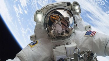 Running repairs: Astronaut Mike Hopkins on a spacewalk last year to replace a faulty water pump outside the International Space Station.