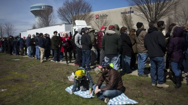 Attendees wait in line before a campaign event for Donald Trump in Bethpage, New York.