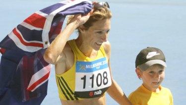 Australia's Kerryn McCann celebrates her marathon victory with son Benton.