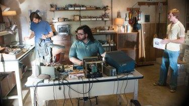 Garage brand: A scene from the biopic <i>Jobs</i> showing Steve Jobs and Steve Wozniak in the Jobs family garage.