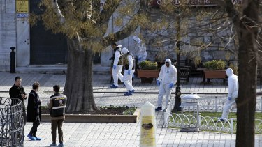 Turkish forensic police officers search for evidence at the site of the suicide bombing, in the historic Sultanahmet district of Istanbul.