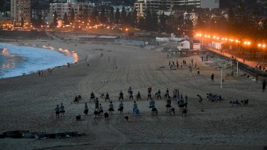 Bathers on Coogee Beach early on Friday before scorching weather sets in over NSW.
